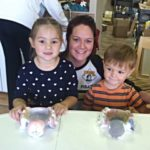 Happy, Smiling Mom and Kids with Spider Bowls